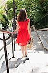 Woman moving down staircases, Montmartre, Paris, Ile-de-France, France