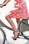 Woman riding a bicycle, Paris, Ile-de-France, France