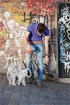 Man showing feces to his puppy, Paris, Ile-de-France, France