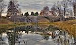 Autumn landscape with arched boulder bridge