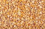 Split dried yellow peas background