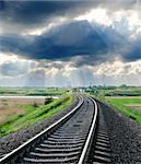 railroad to horizon under cloudy sky