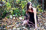 Teenage Girl amongst Autumn Leaves