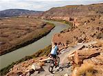 Woman mountain biking in Fruita