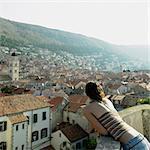 Young woman overlooking Dubrovnik, Croatia