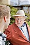 Young man and senior talking