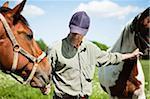 Close-up of man feeding horse