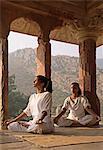 Women practising yoga in the abandoned town of Bhangarh, Alwar, Rajasthan, India, Asia
