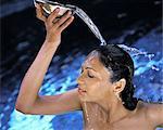 Indian woman taking a bath, India, Asia