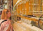 Female tourist shopping, Gold Souk Market, Deira, Dubai, United Arab Emirates, Middle East