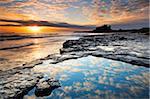 Spectacular sunrise on the coast near Bamburgh Castle, Northumberland, England, United Kingdom, Europe