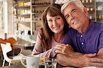Older couple having breakfast in cafe