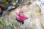 Teenage Girl Standing on Rock