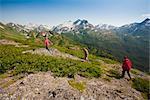 Visitors hiking on ridge in Kenai Mountains near Homer, Kenai Penninsula, Alaska, Summer