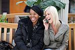 Two young women listen to a cellphone conversation, Pietermaritzburg, KwaZulu-Natal, South Africa