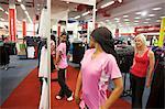 Two young women trying on sportswear, Pietermaritzburg, KwaZulu-Natal, South Africa