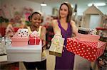 Two young women holding presents, Pietermaritzburg, KwaZulu-Natal, South Africa, friendship