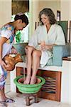 Woman getting a footbath at a spa in Mexico.