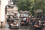 Tourist boats on canal, old town of Wuzhen, Zhejiang, China