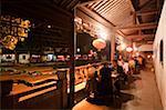 Local restaurant on the bridge, old town of Xitang at night, Zhejiang, China