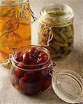 jars of cherries, gherkins and  seasoning