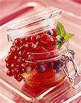summer fruit in glass jar