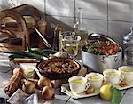 Provençal menu with onion and anchovy Pissaladière tart, casserolle knuckle of ham and lemon mousse