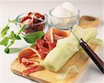Preparing salad ingredients on chopping board