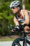 Woman riding road bike, portrait