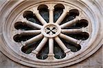 Croatia, Trogir, Central Europe. Detail of a window on a church. UNESCO