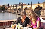Europe, Czech Republic, Central Bohemia Region, Prague. Riverside Cafe.