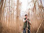 Farmer gathering elephant grass