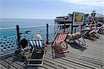 Deckchairs on Brighton Pier, Brighton, Sussex, England