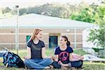 Two Teenage Girls Meditating on School Grounds