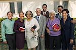 Christian Family sur patio holding Bibles, portrait