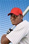 Baseball batter during practice, (portrait)