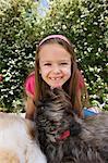 Dog Licking Little Girl's Chin