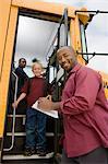 Teacher Unloading Elementary Students from School Bus