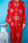 Woman wearing red silk Chinese pajamas