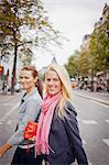Portrait of two women walking in street