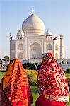 Women in colourful saris at the Taj Mahal, UNESCO World Heritage Site, Agra, Uttar Pradesh state, India, Asia