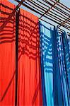 Freshly dyed fabric hanging to dry, Sari garment factory, Rajasthan, India, Asia