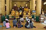 Visitors praying, Shwedagon Pagoda, Yangon (Rangoon), Myanmar (Burma), Asia