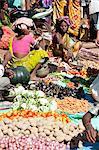 Mali tribeswomen selling vegetables at weekly market, Rayagader, Orissa, India, Asia