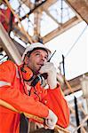 Worker with walkie talkie on site