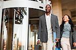 Business people walking outside building