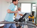 Man using treadmill in gym