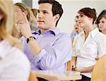 Business people sitting in seminar
