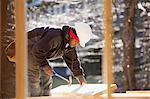 Carpenter a hammer lifting rafter
