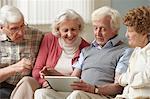 Senior adults using digital tablet